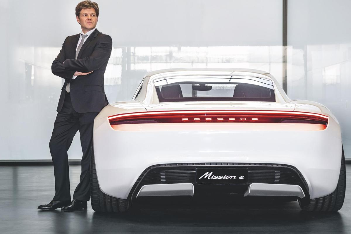 Porsche's Stefan Weckbach pictured alongside the car he is in charge of developing, the forthcoming electric Taycan