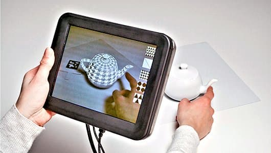 Disney's REVEL system applying virtual textures to different areas of a teapot (Photo: Disney Research)