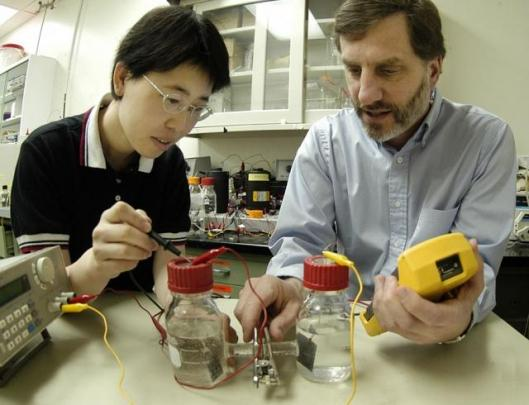 Dr. Hong Liu (left) , postdoctoral researcher in environmental engineering, and Dr. Bruce Logan (right), Kappe professor of environmental engineering, with hydrogen generating microbial fuel cell. Photo: Greg Grieco, Penn State