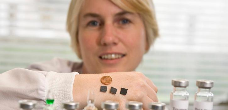 Dr. Anne Moore displays the microneedle patch