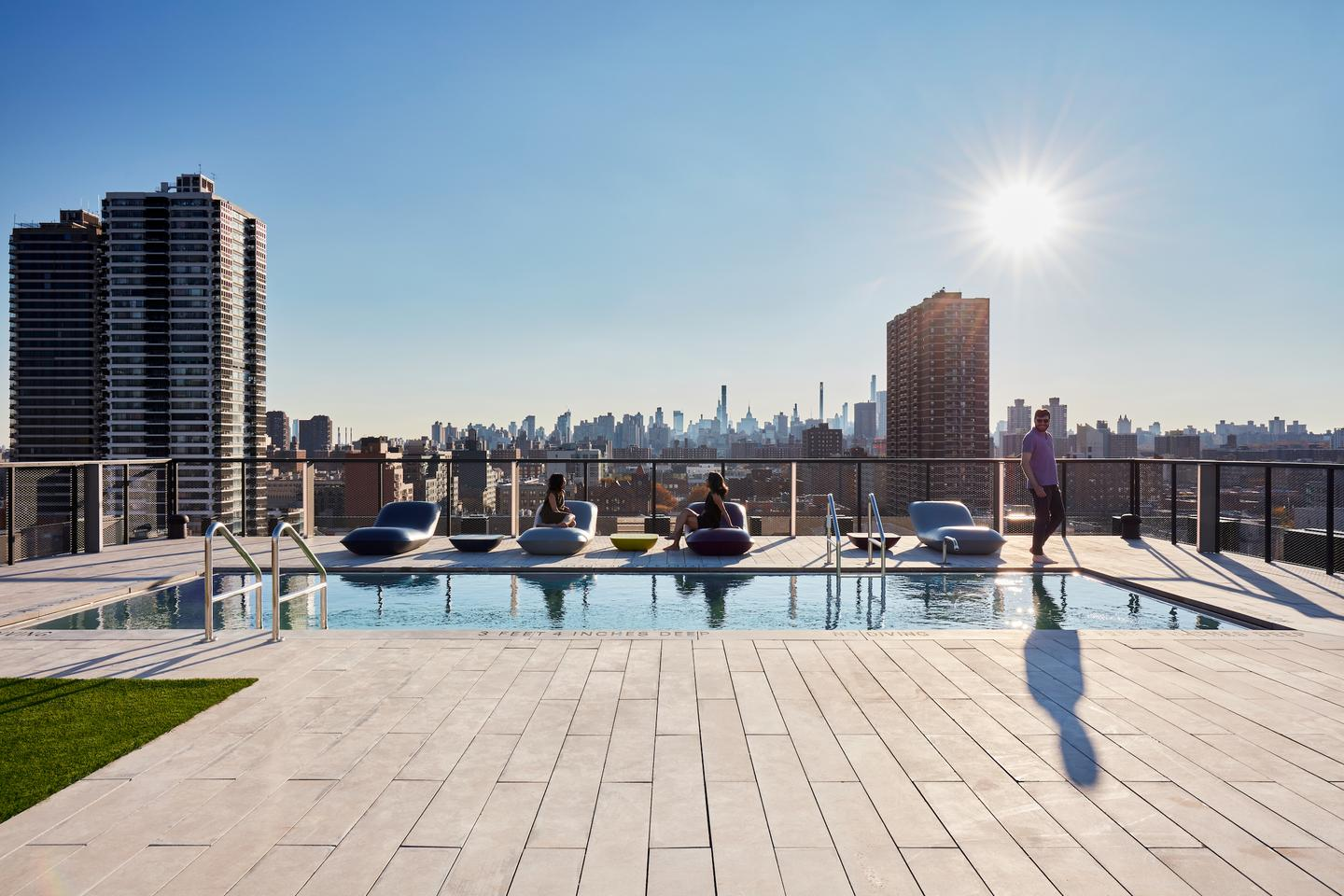 The Smile's rooftop terrace area includes one swimming pool and three hot tubs for residents to enjoy