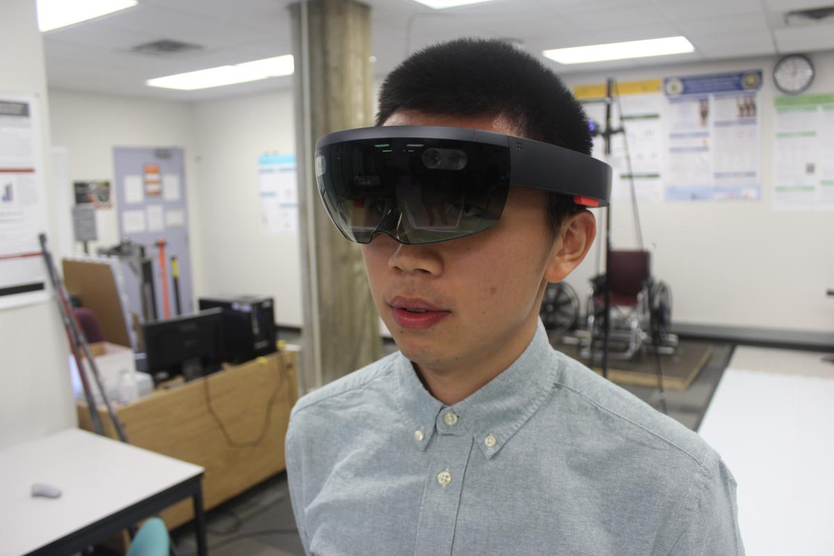 Michael Xiu, with the system's AR goggles