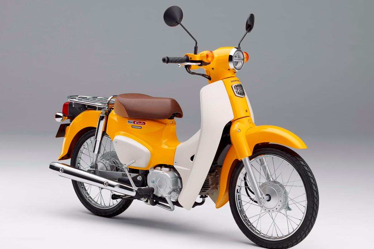 The 2018 Honda Super Cub in Pearl Shining Yellow color
