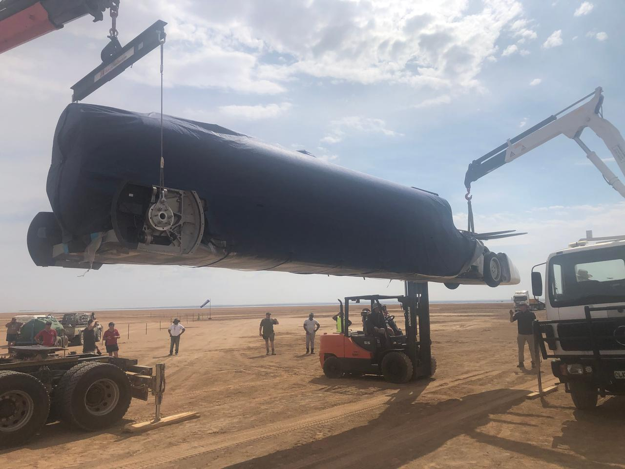 The Bloodhound LSR supersonic car is lowered onto the desert in Northern Cape, South Africa