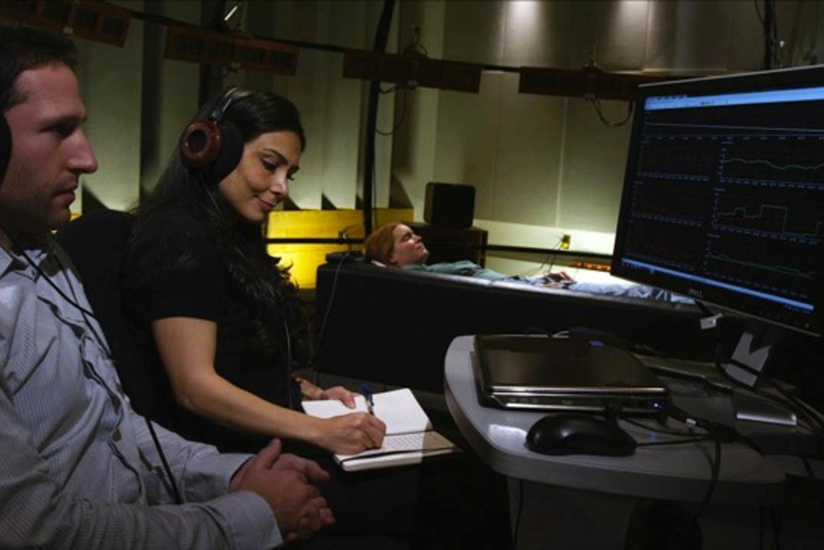 Researcher Valorie Salimpoor and colleague Mitchel Benovoy observe a volunteer as she listens to some of her favorite music