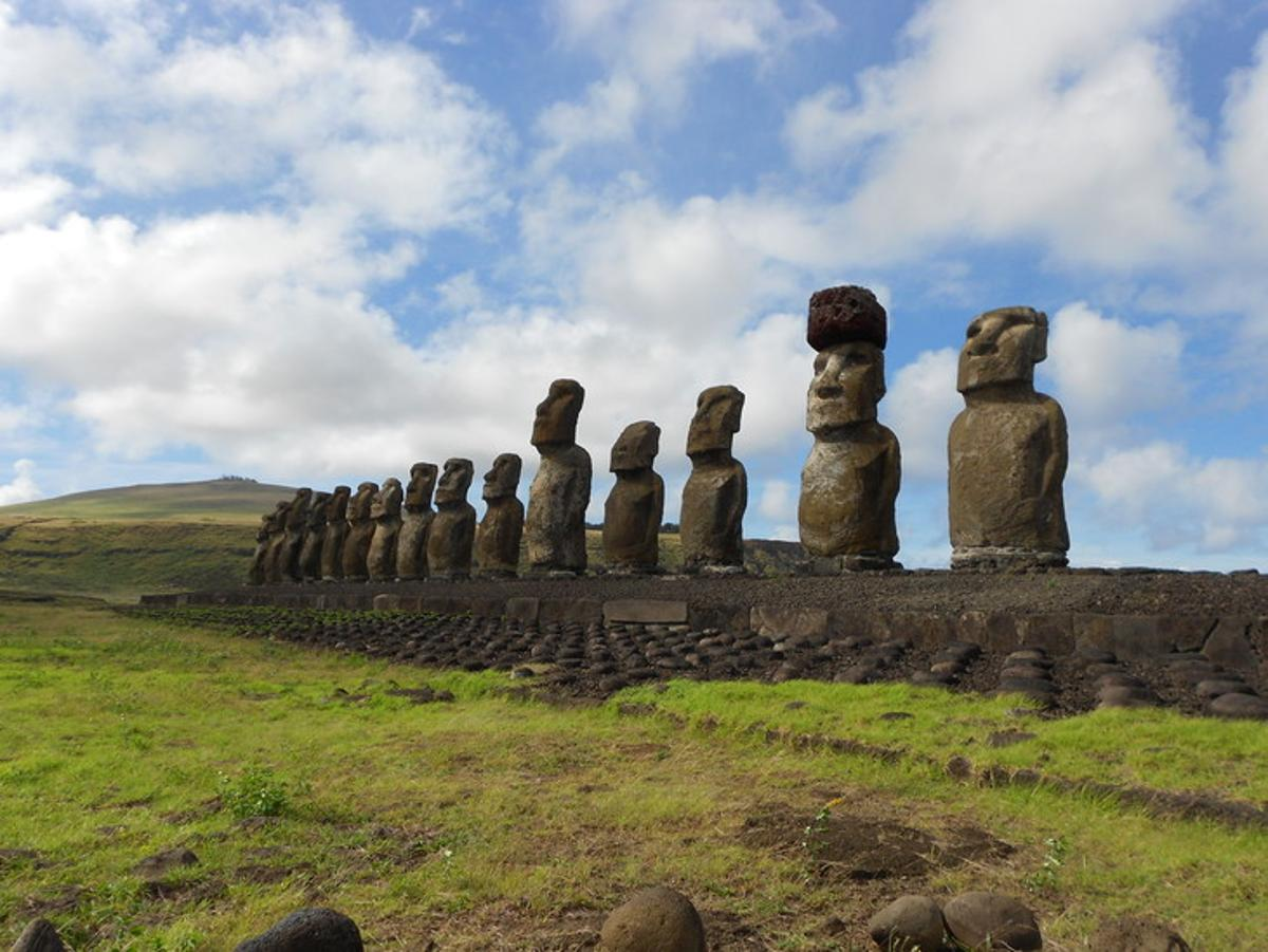 A row of moai statues on Easter Island, with the second fromthe right wearing a pukao (red stone hat)