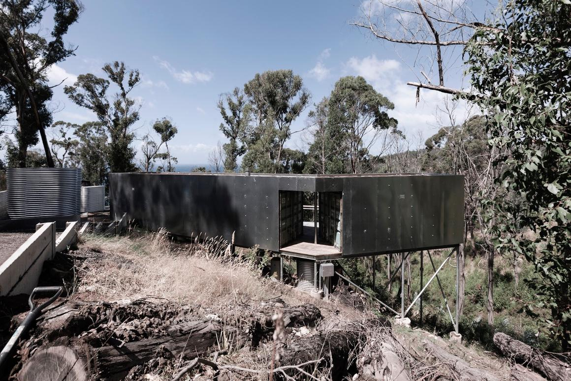 House 28comprises three 20 ft (6.1 m)-long containers clad in galvanized steel