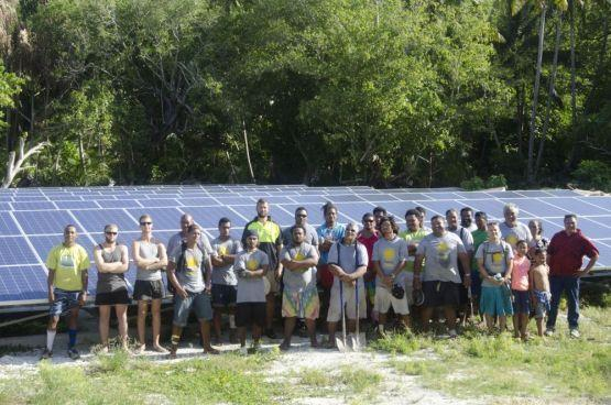 Workers install a solar array in Tokelau, an island nation that will be powered with renewable energy from September 2012