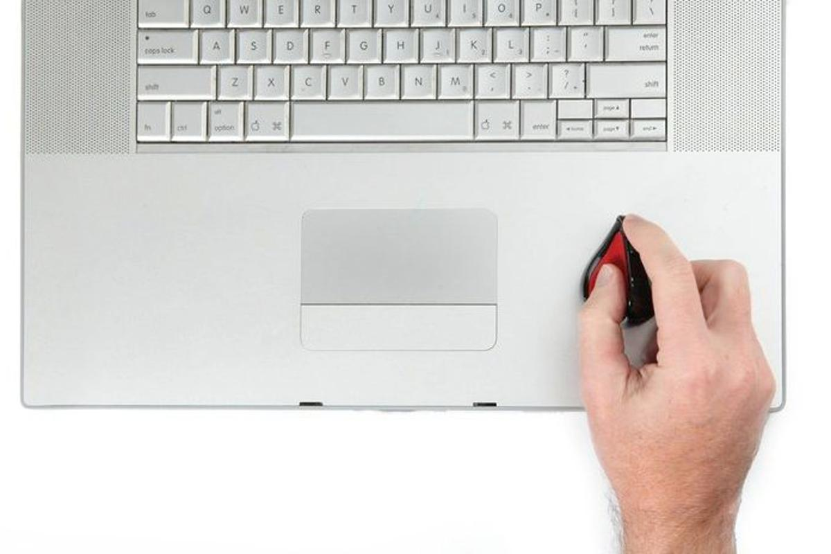 The Swiftmouse offers pen-like comfort and traditional mouse functionality while sitting on top of a laptop's palm rest