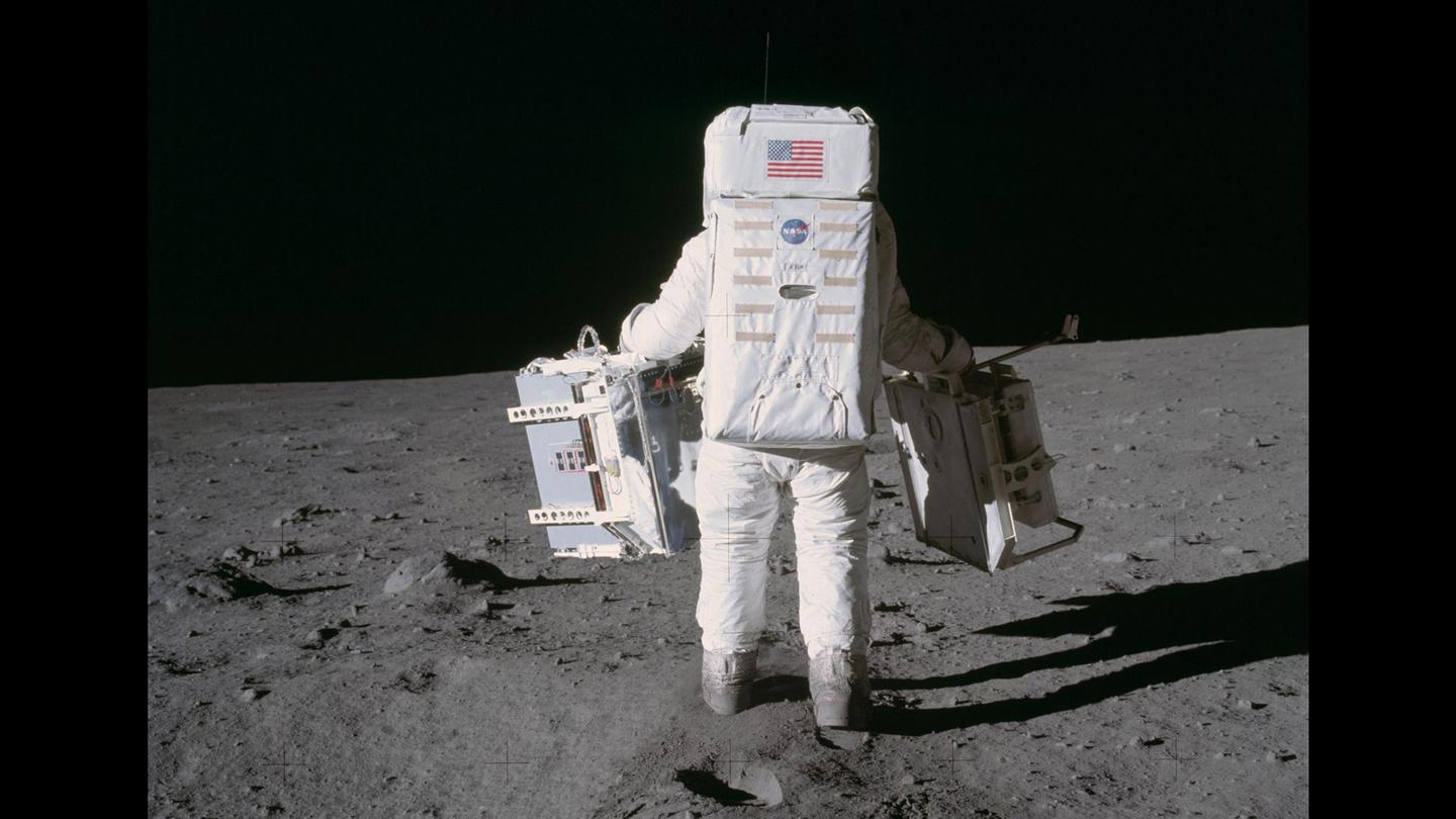 Buzz Aldrin pictured during the Apollo 11 mission carrying a Laser Ranging Retro-Reflector in his right hand