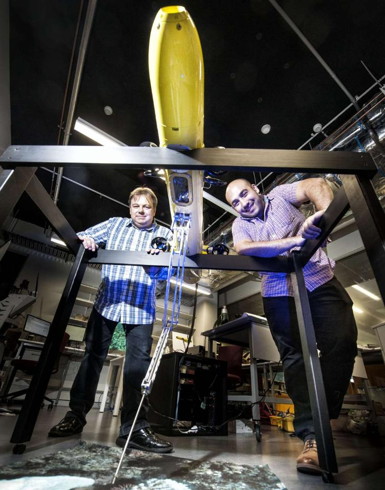 Developers of the COTSbot, Drs Matthew Dunbabin (left) and Feras Dayoub (right)