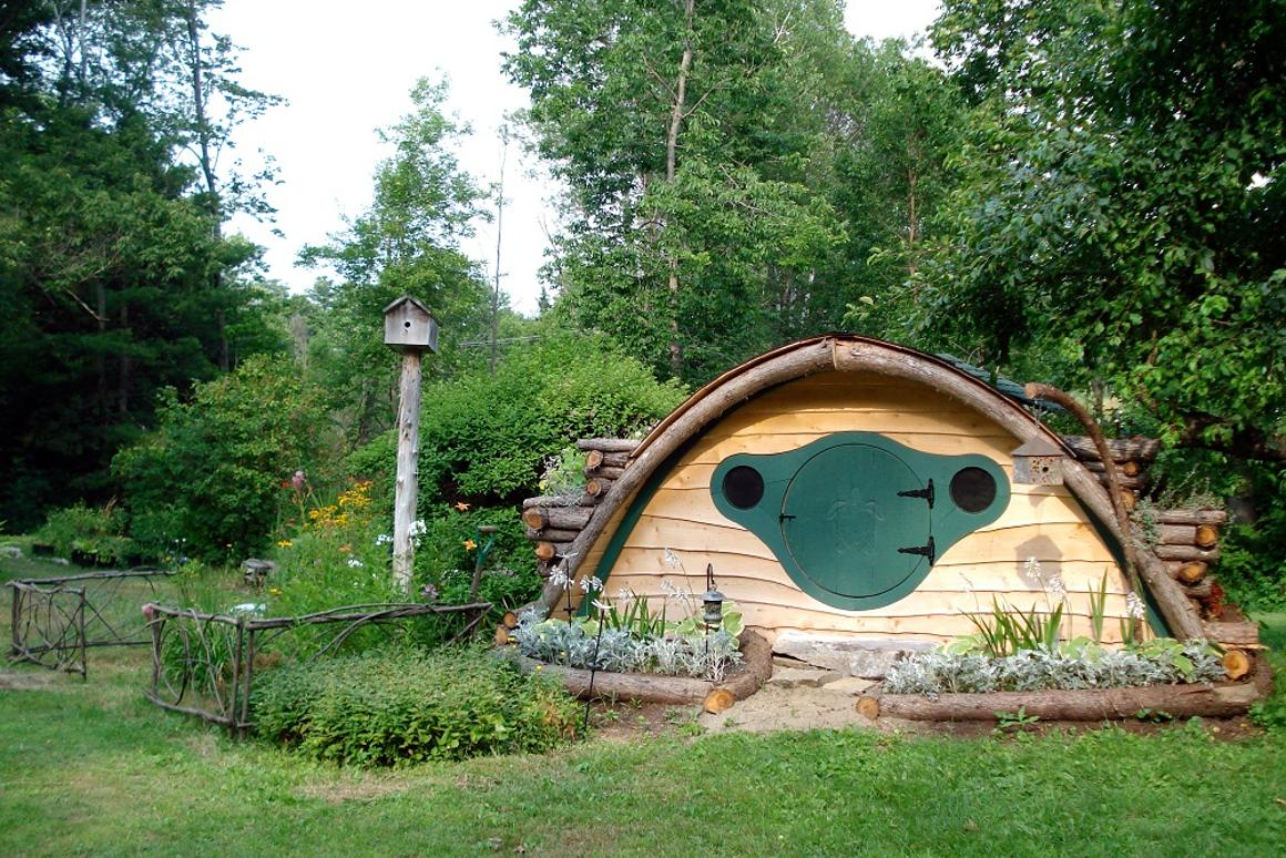 A multipurpose Hobbit Hole that can be used as a playhouse, or a storage shed for gardening tools and supplies (Photo: wooden-wonders.com)