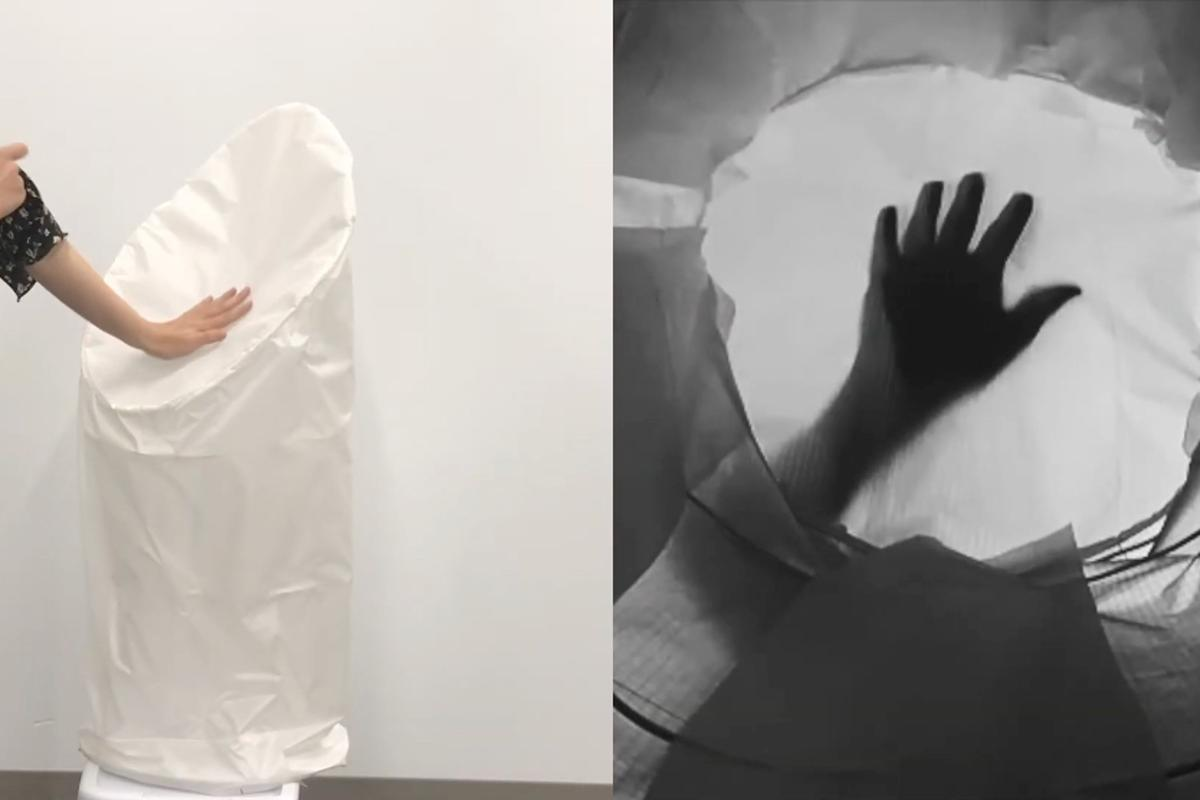 """The ShadowSense prototype """"sees"""" the shadow of a user's hand (right) as they touch the robot's skin"""