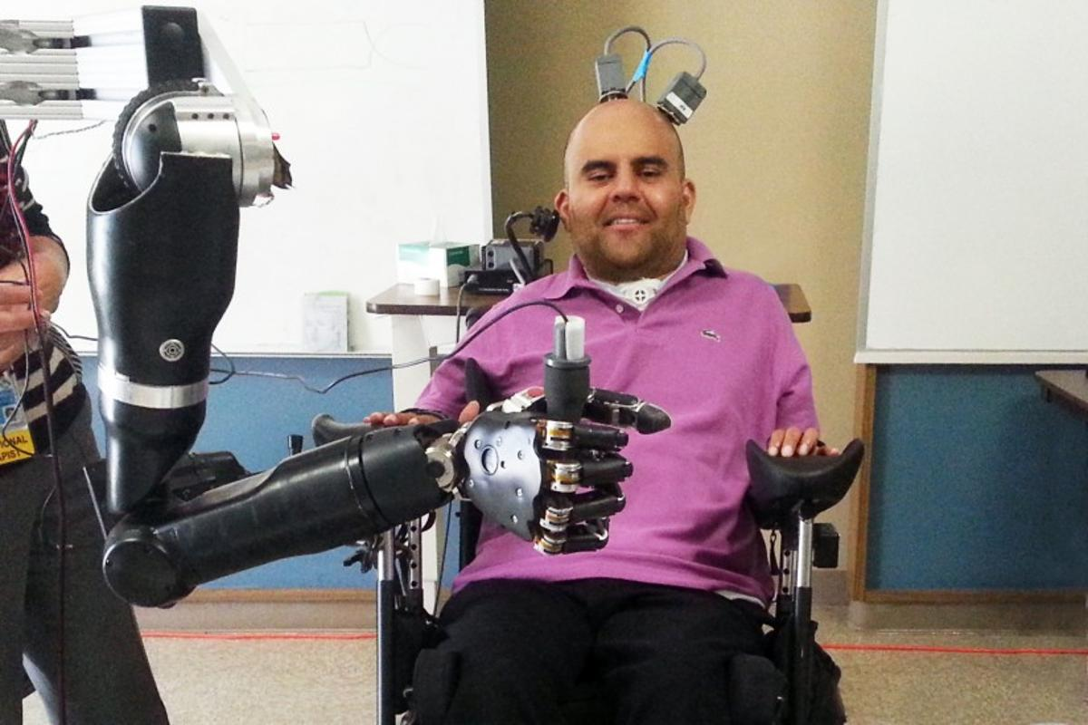 "Erik G. Sorto controls the ""mind-reading"" robotic arm"