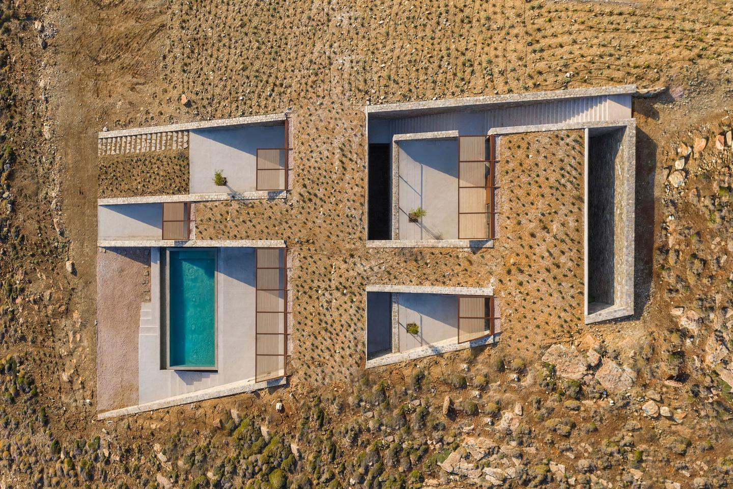 The NCaved house, by Mold Architects, takes its place remarkably well among the rugged shoreline on Greece's Serifos island