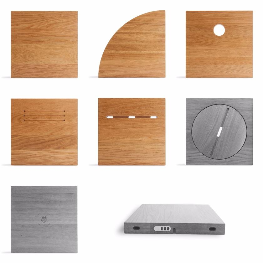 Modulos Desk wooden modules include a square flat piece, a rounded corner block, static or rotating tablet holders and a wireless charging surface