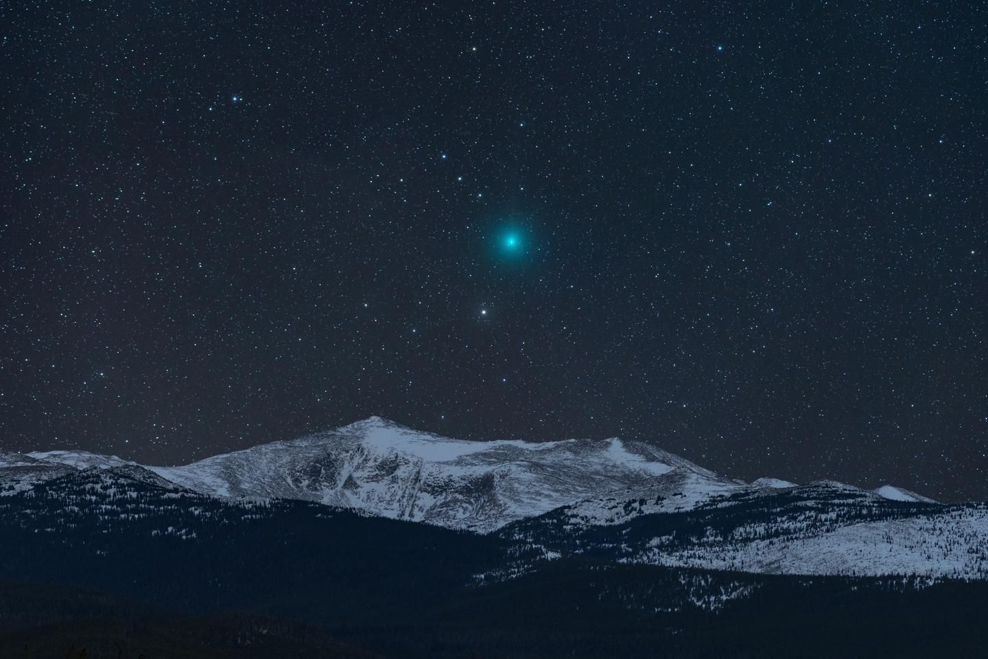 The photographer has been wanting to get an image like this for years, but bright comets have been lacking. Then along came 46P/Wirtanen. The photographer used software to simulate the view and it showed that the comet would set over Loaf Mountain in the Bighorns at 3 a.m. on that particular night in early December. These mountains are often too windy for long exposures, but everything came together. Using a tracking mount, the photographer shot a 4-panel mosaic of the comet and two additional exposures of the snowy mountain and later combined everything together.Buffalo, Wyoming, USA, 7 December 2018
