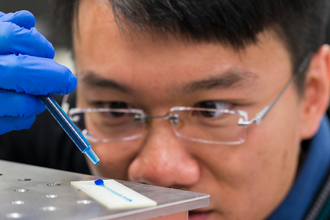 William Wong places a drop of water on the material