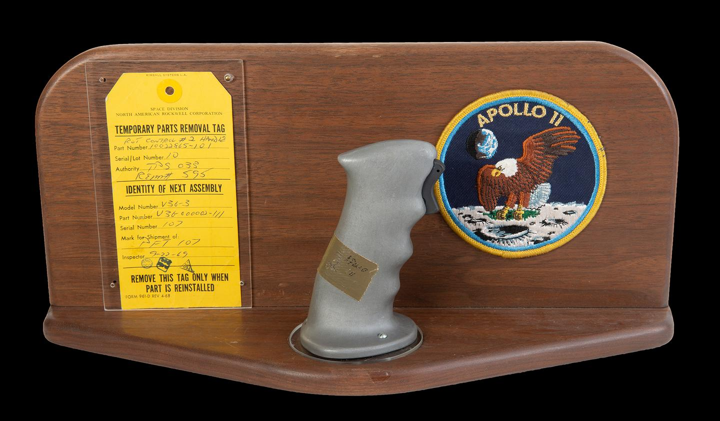$370,000 | Neil Armstrong's Apollo 11 Control Joystick | Julien's Auctions | Estimate: $100,000 - $200,000 | 18 July 2020 | The original rotational attitude control stick (aka rotation hand controller) from the Apollo 11 command module Columbia in 1969. This control handle, located near the right hand of astronaut and mission commander Neil Armstrong (positioned in the left couch of the command module) allowed navigation of the spacecraft's attitude using roll, pitch, and yaw adjustments. The control stick is fitted with a trigger switch for activating the headset microphone. Included is a wooden display mount with an Apollo 11 mission patch and the original parts removal tag (dated September 22, 1969) with matching serial numbers and official NASA stamps. Part number 10022865-101. Serial number 10. NOTE: The provenance of this item has been corroborated by an official NASA audit report published by the Office of Inspector General in 2018.