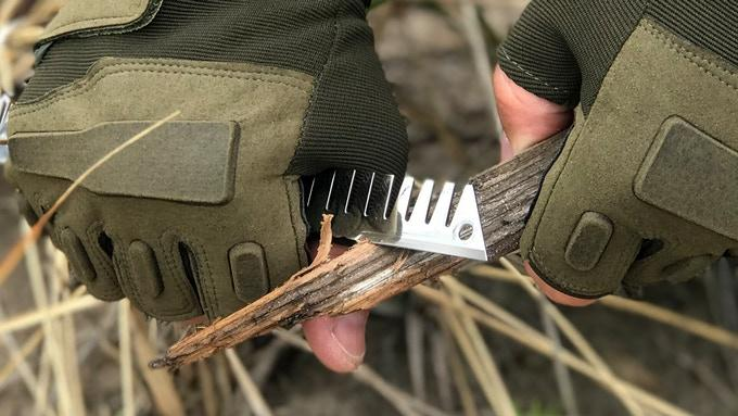 One of the arms of the Survival Stove Head tool features a sharp edge that enables it to work like a knife, either to open the can or to cut up kindling