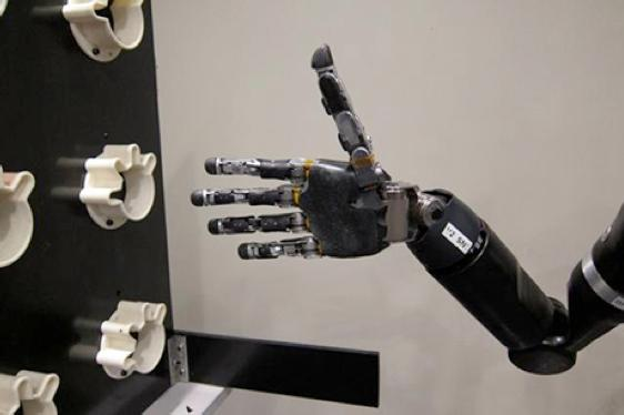Quadriplegic Jan Scheuermann gave the mind-controlled robotic arm a big thumbs up at the end of her trial period (Photo: Journal of Neural Engineering/IOP Publishing)