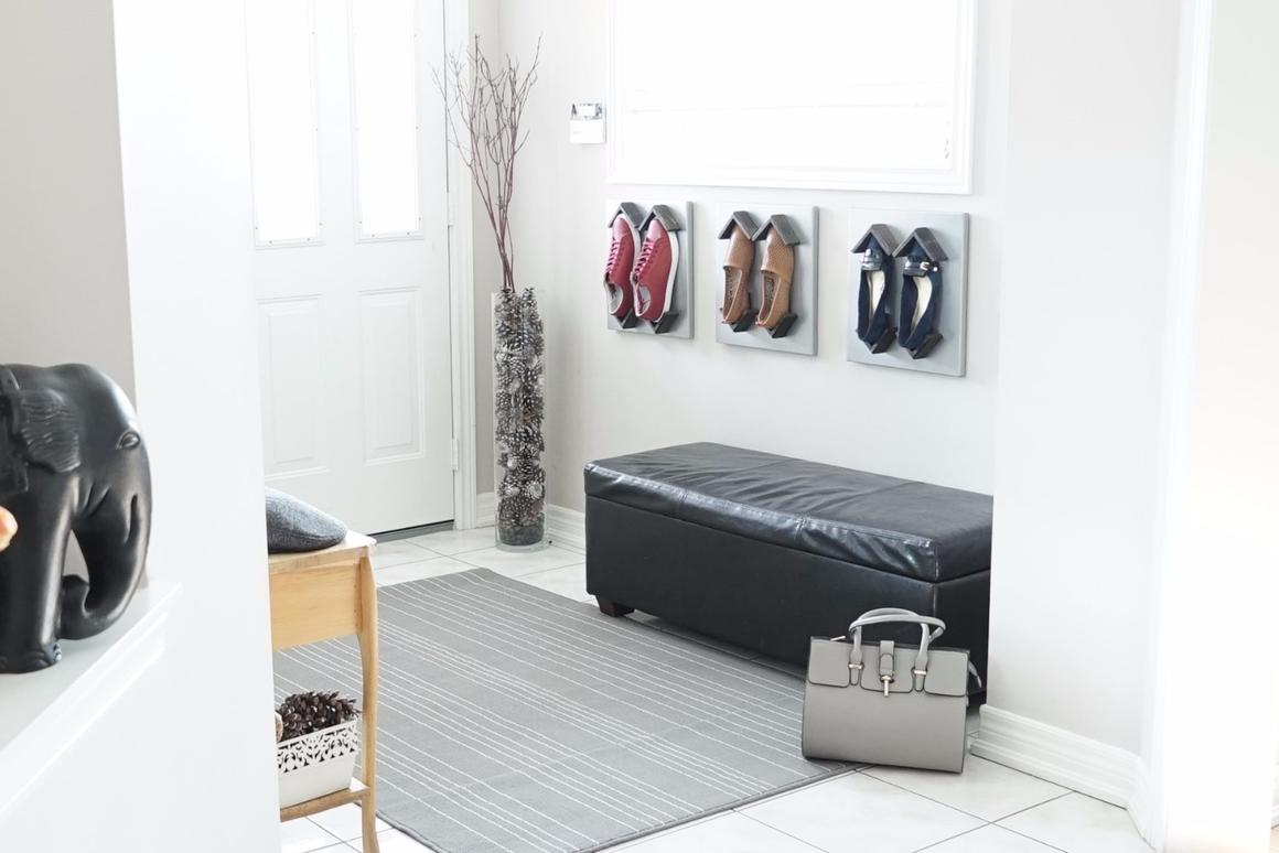 The Shoeblox consist of a wall-mounted panel and movable brackets that stick to the panel