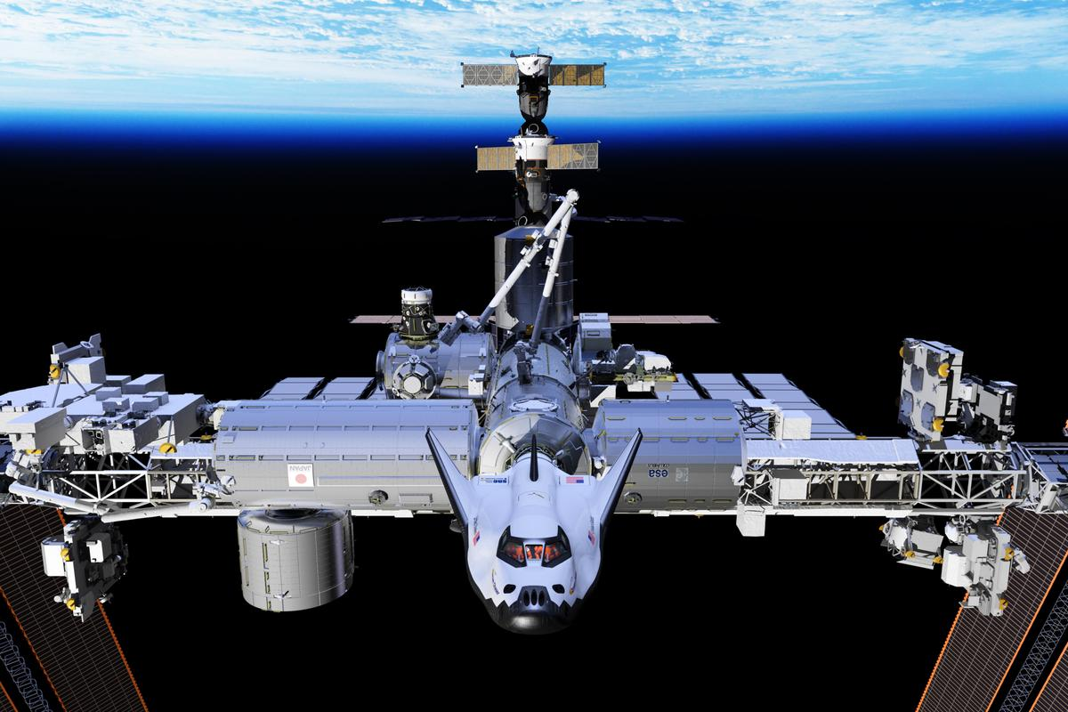 A concept image of Sierra Corporation's Dream Chaser at the International Space Station (Image: SNC)