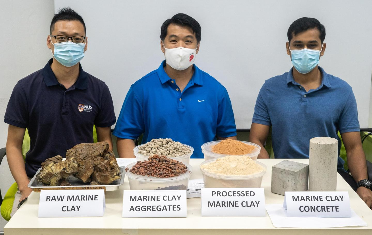 Researchers from the National University of Singapore' Centre for Advanced Materials with samples of their eco-friendly concrete that incorporates waste clay