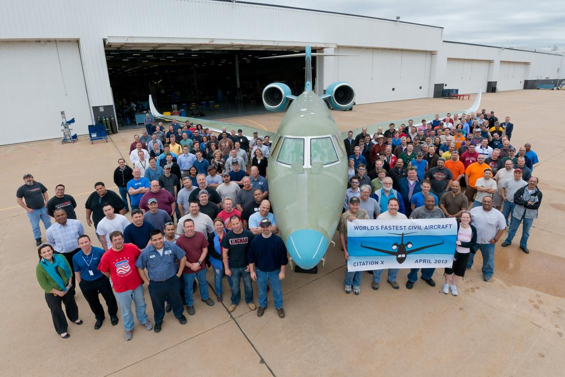 Cessna employees celebrate the first production new Citation X
