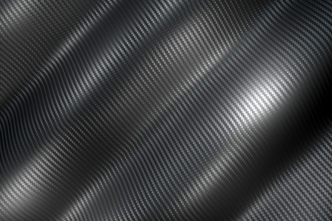 Can carbon fiber car panels double as energy storage materials?