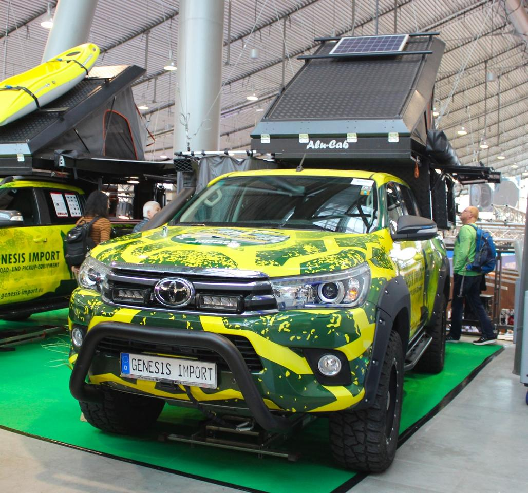 Genesis Import shows a Toyota expedition pickup with Alu-Cab pop-top camper