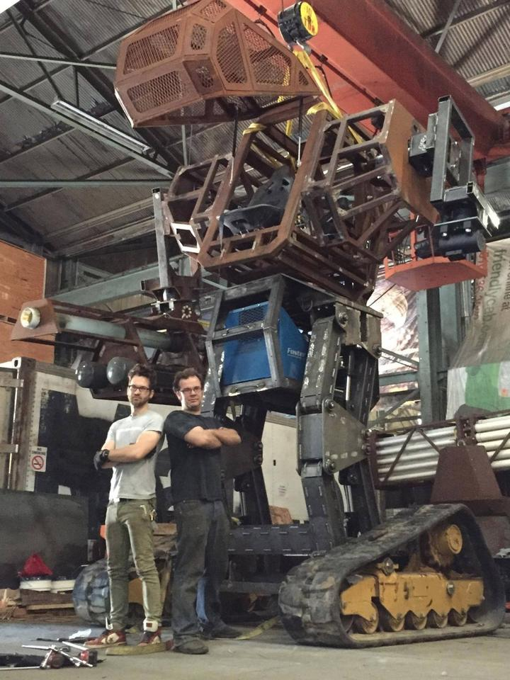 The 15-foot tall Megabot, with co-creators Gui Cavalcanti and Matt Oehrlein