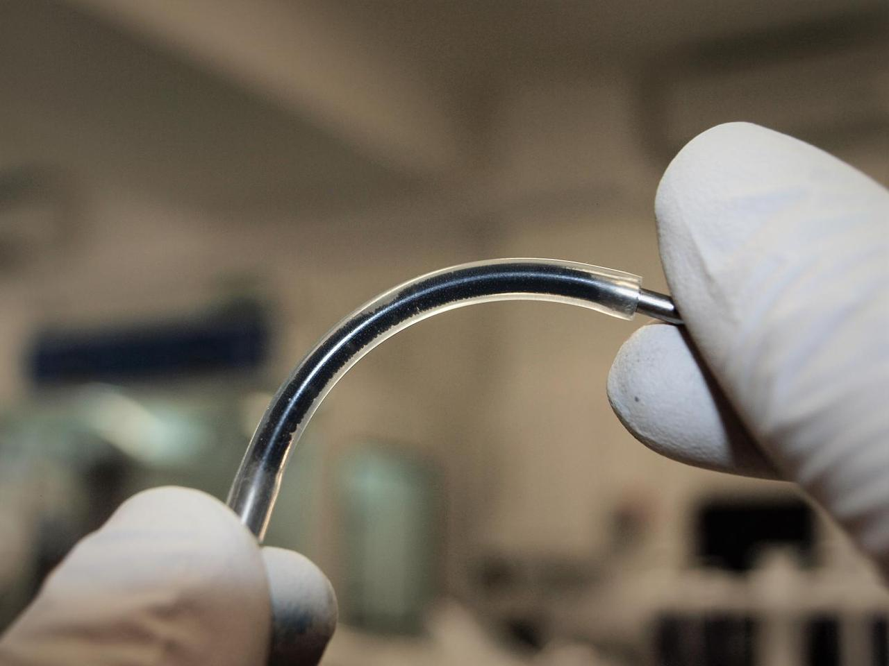 A flexible tube, filled with an emulsion of water, oil and graphene