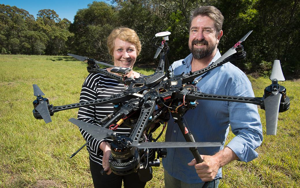 Dr. Sandra Johnson and Dr. Grant Hamilton with one of the drones