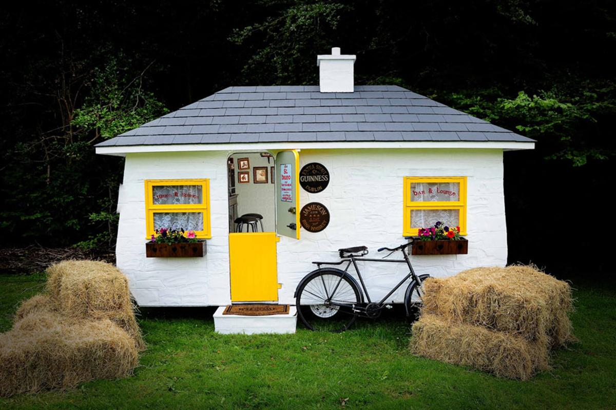 The Shebeen portable pub comes well-stocked and includes glasses, alcohol, mixers, and everything else you'd need for a good time