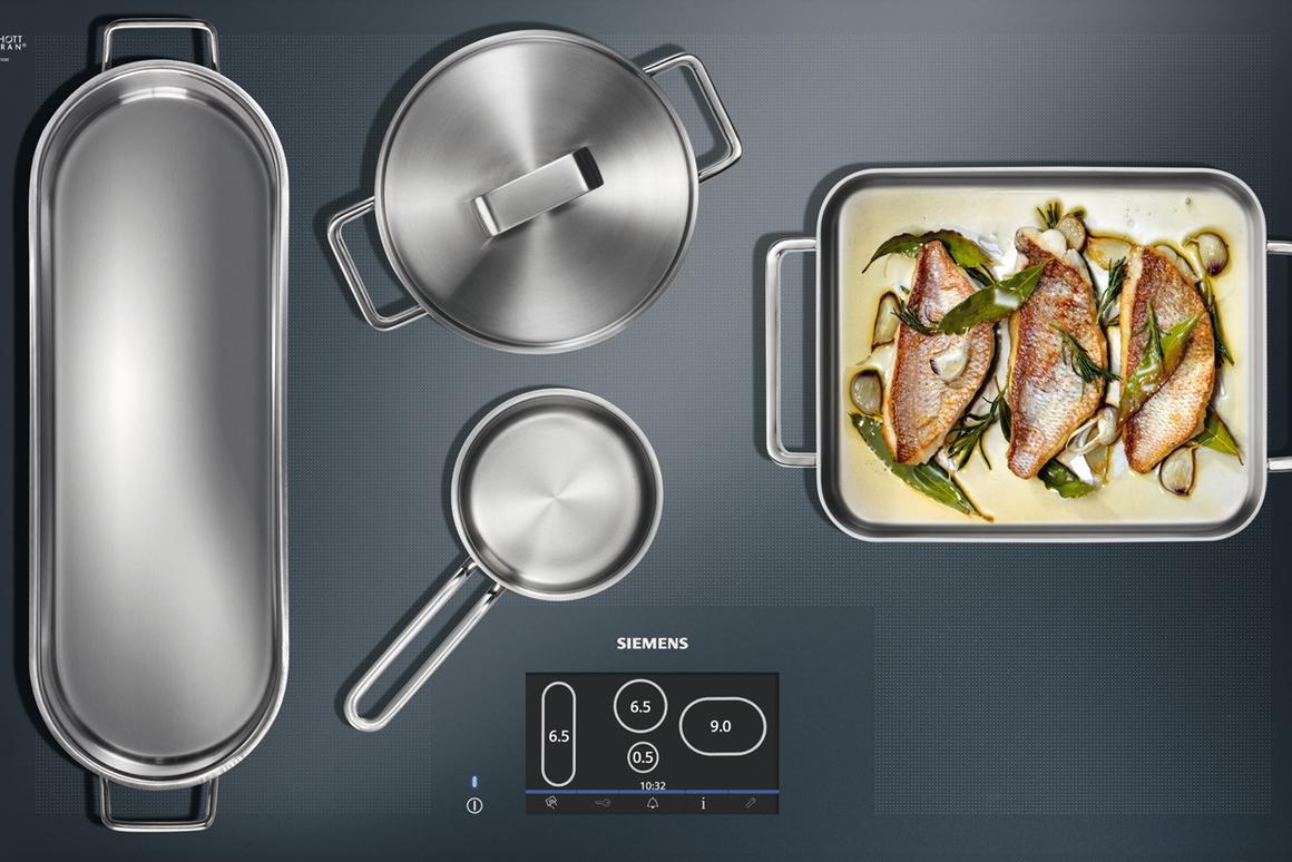 Siemens' full-surface induction cooktop allows up to four pieces of cookware to be placed anywhere on its surface