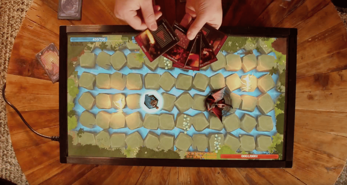 PlayTable is a gaming console that can be played using physical game pieces, or users' mobile phones
