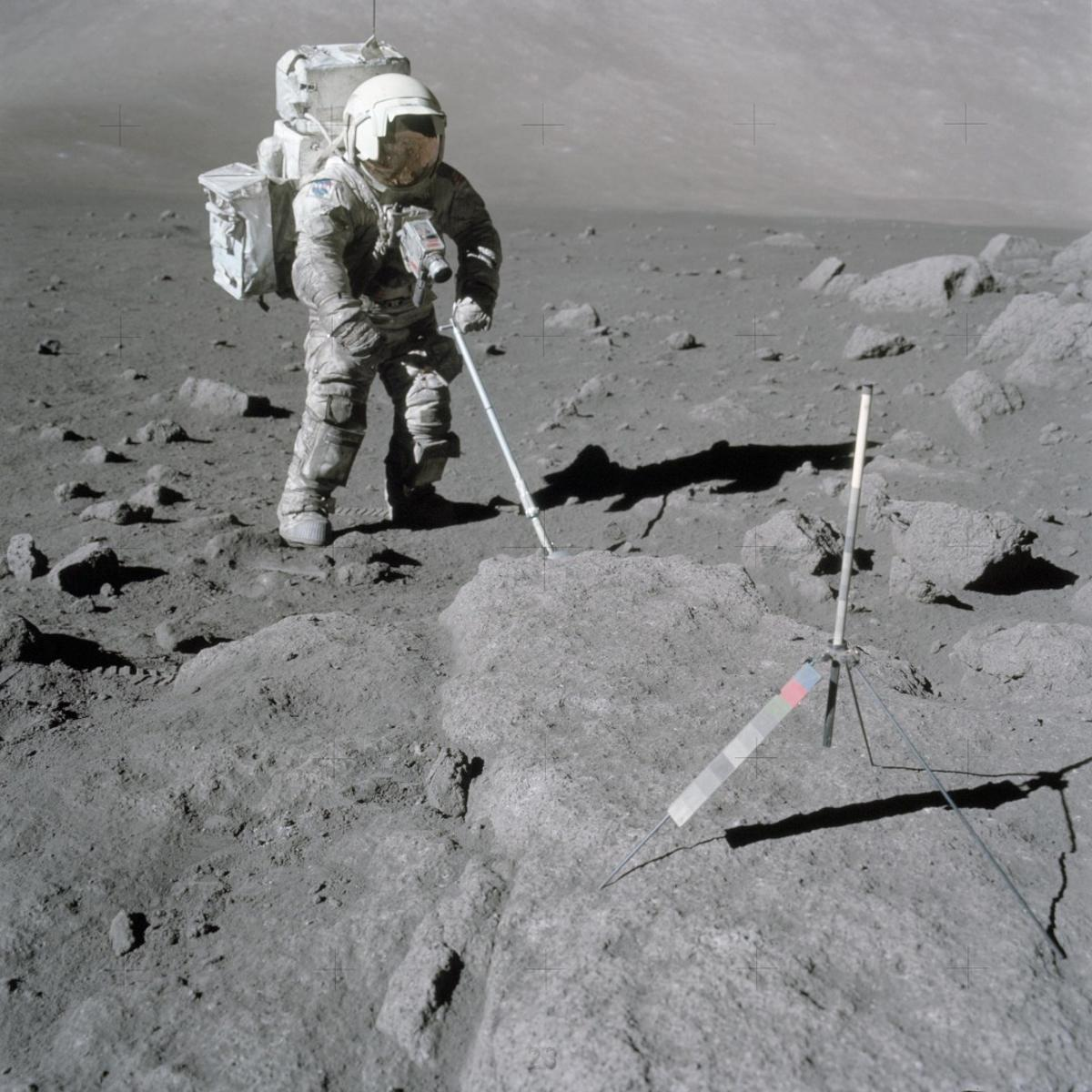 NASA astronaut Harrison Schmitt retrieves lunar samples