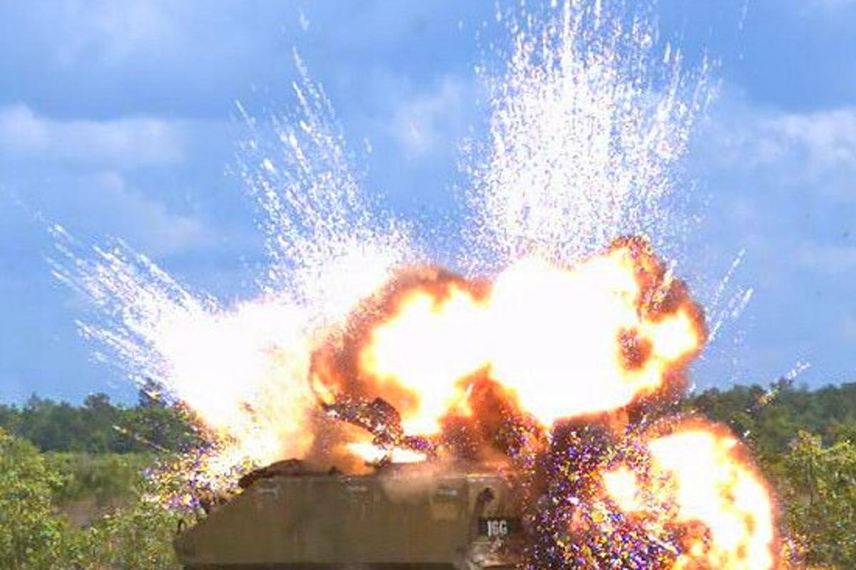 Detonation of a laser-guided warhead on an armored personnel carrier (Photo: Eglin AFB 780th Test Squadron)
