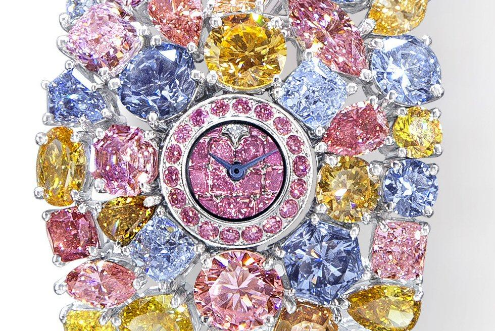 The Hallucination's petite watch face in the center of over 110 carats of rare colored diamonds almost seems like an afterthought