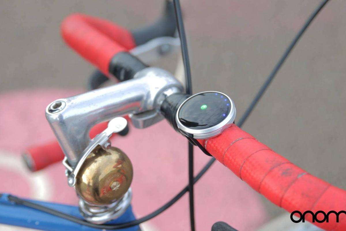 Haize is a small, circular navigation device that can be mounted on the handlebars of any bike