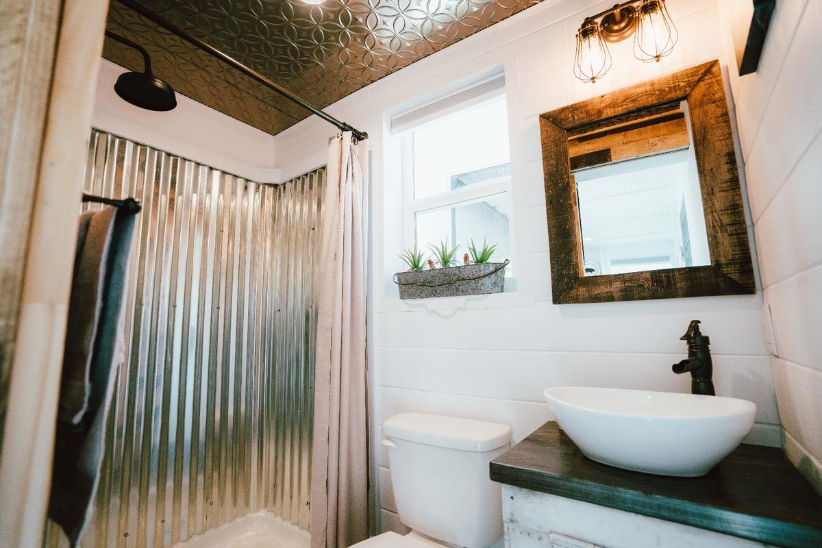 The City's bathroom includes galvanized steel-lined shower