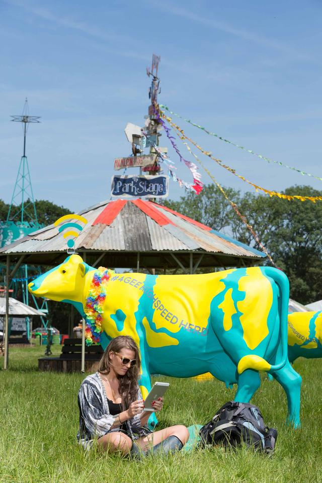 The cows combine whimsical art with high-tech electronics
