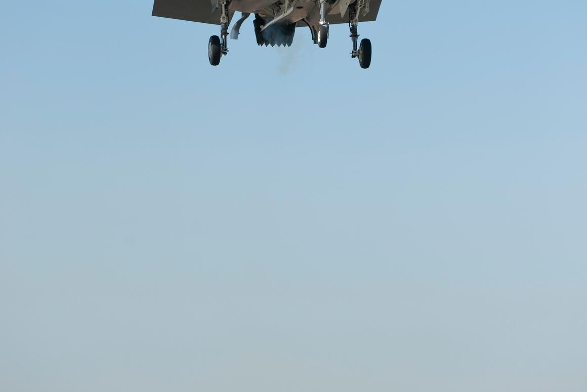 The Lockheed Martin F-35B begins descending to its first vertical landing March 18, 2010. (Lockheed Martin Photo by Damien A. Guarnieri)