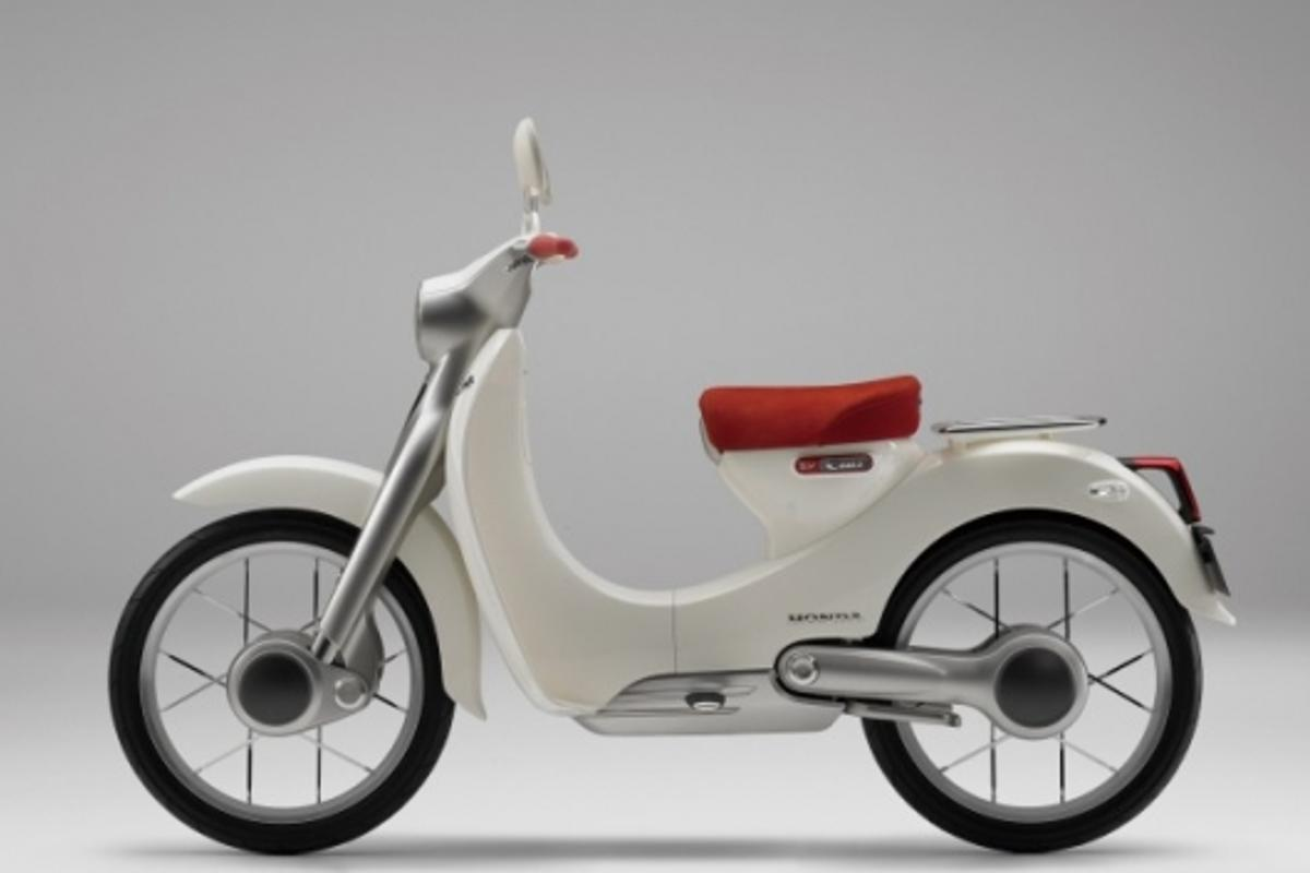 The side view of the EV-Cub electric motorcycle