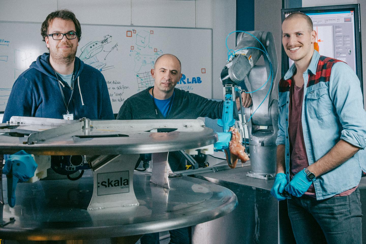 SINTEF researchers Elling Ruud Øye, Ekrem Misimi and Aleksander Eilertsen (left to right) with Gribbot