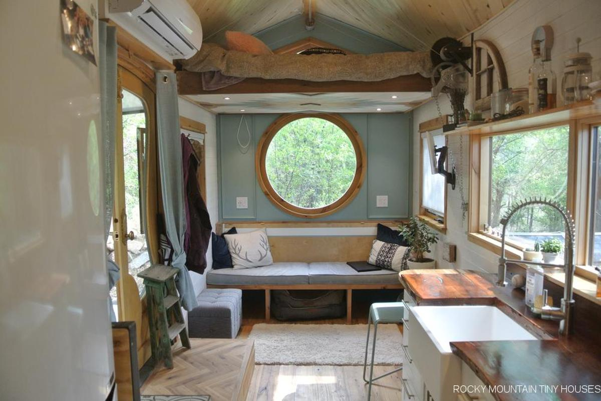 The San Juan Tiny House features a manually-elevated bed, seen here in the raised position