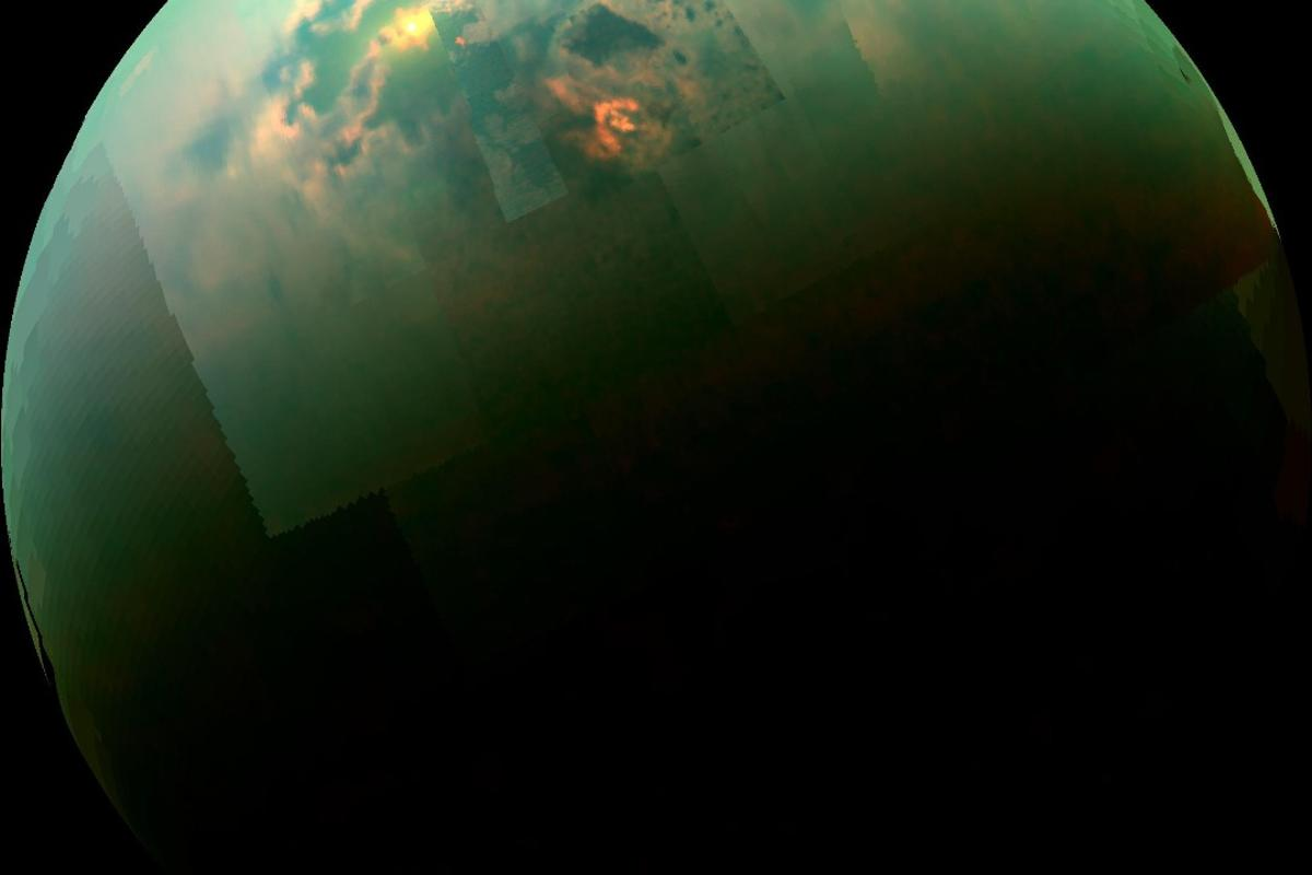 A near-infrared, color mosaic from NASA's Cassini spacecraft shows the sun glinting off of Titan's north polar seas