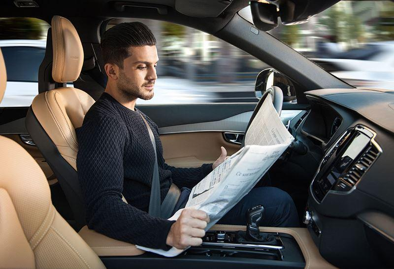 Will cars ever be smart enough that we can read the paper instead of the road while we're driving?