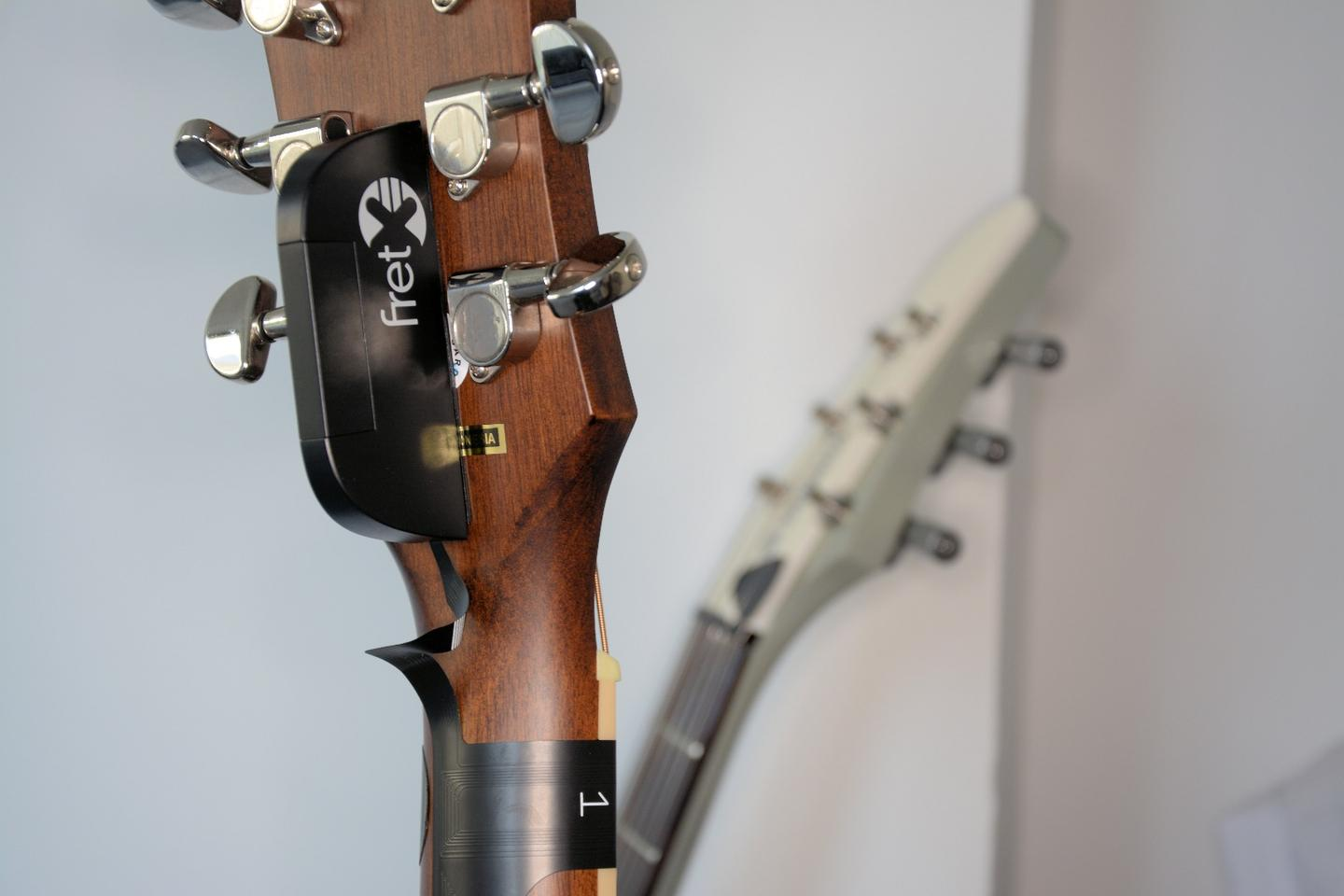 The FretX control box sits at the back of the headstock, in this case between the tuning machines of our dreadnought test mule